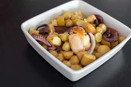 Plate with Baked Octopus with Potatoes.
