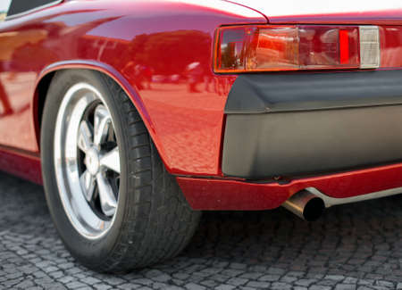 Close-up view of red retro car headlight.