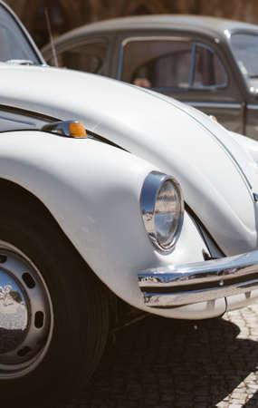 Close-up view of white retro car headlight. Stock Photo