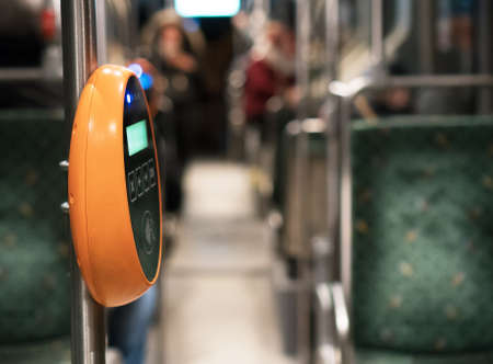 Ticket validation system on modern public transport. Stock Photo
