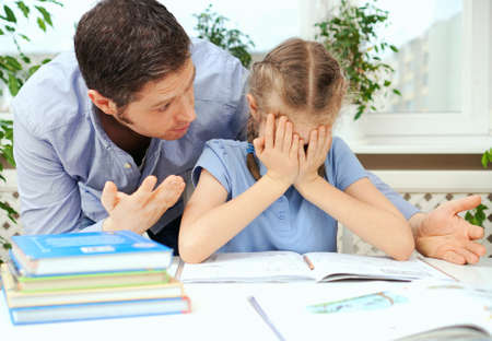 Dad is angry because his daughter dont want to do her homework.