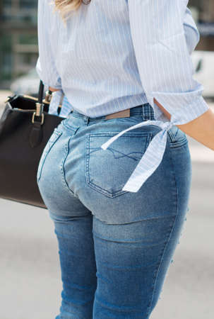 Woman with big artificial buttocks on the street.