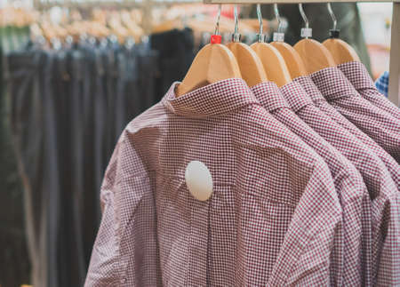 Mens shirts in a clothing store. Stock Photo