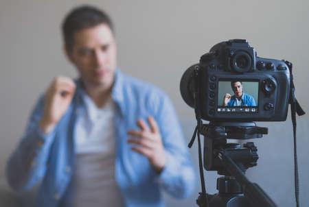 Handsome man making video blog. Focus on camera. Reklamní fotografie