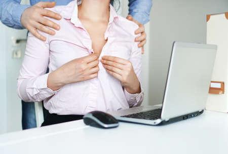 Sexual flirt at work. Secretary's unbuttons her blouse. 스톡 콘텐츠