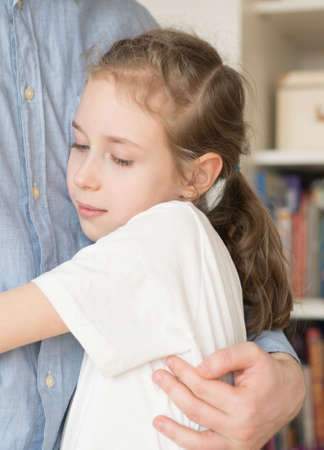 Cute little girl hugging her dad. Stock Photo