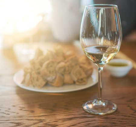 Glass of white wine is on the table. Wine degustation.