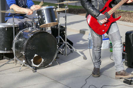Street musicians playing on guitar and drums. Unrecognizable persons. 写真素材