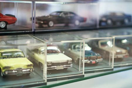 Collection of retro toy car models in shop window. Stock Photo