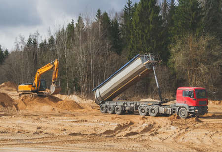 Construction of new transport road through the forest. Beginning of work. Stock Photo