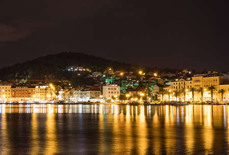 Beautiful view on the old town and Marjan park in Split, Croatia at night.