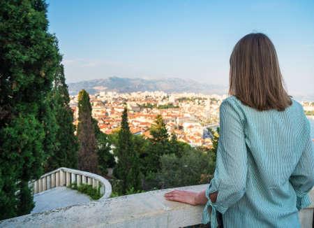 Woman enjoying views of the old town of Split. Stock Photo