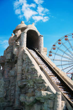 Water roller coaster in amusement park at summer.