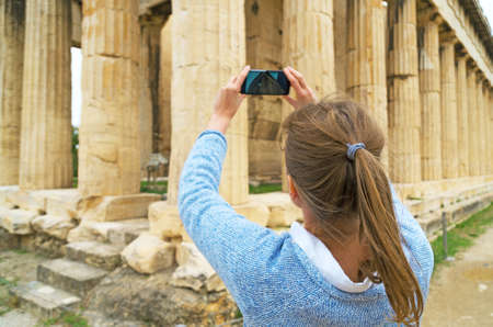 Woman photographing Temple of Hephaestus in Athens, Greece. Archivio Fotografico