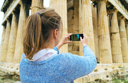 Woman photographing Temple of Hephaestus in Athens, Greece. Stock Photo