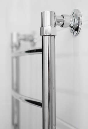 Close-up view of Heated towel rail in bathroom.