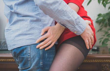Sexual flirt at work. Man touching woman's butt. Standard-Bild