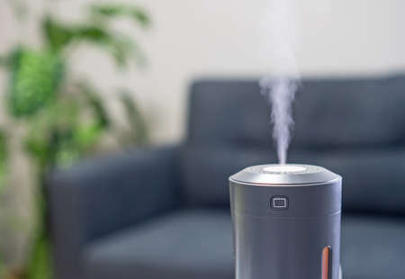 Electric air humidifier at home. Place for text.