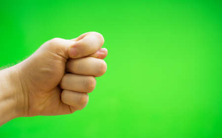 Male hand shows fig sign. Chroma key. Place for your advertisement. Stock Photo