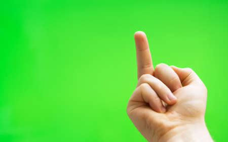 Male hand shows middle finger. Chroma key. Place for your advertisement.