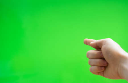 Male hand pointing to something. Chroma key. Place for your advertisement.