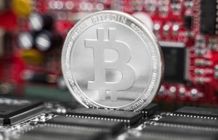 Silver bitcoin and video card. Cryptocurrency mining concept.