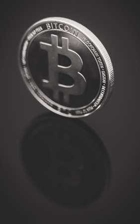 Physical version of silver bitcoin. Place for your text. 免版税图像