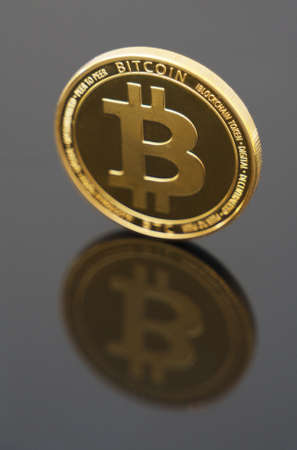 Physical version of golden bitcoin. Place for your text.