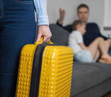Domestic quarrel. Mother with suitcase leaving his family. Reklamní fotografie