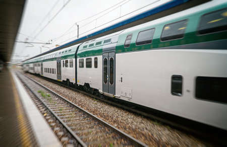 Double-decker train at the railway station in Italy. Zdjęcie Seryjne - 122883720