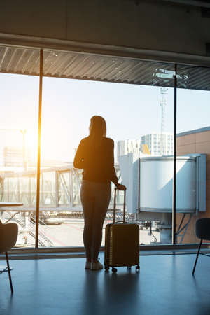 Young woman with luggage in the airport. Stock Photo - 122883730