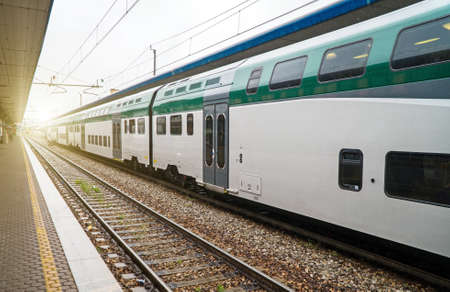 Double-decker train at the railway station in Italy. Reklamní fotografie