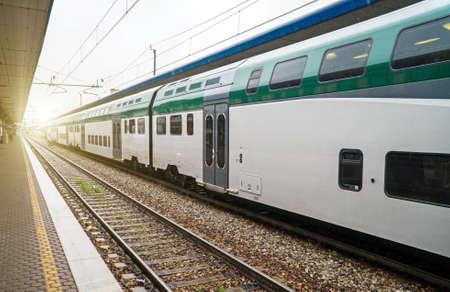 Double-decker train at the railway station in Italy. Zdjęcie Seryjne