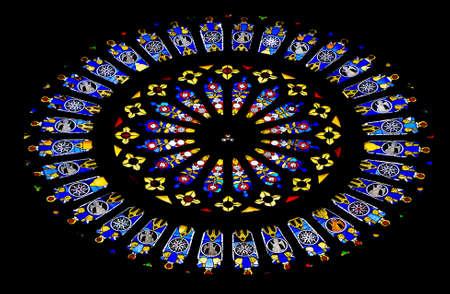 Round stained glass window inside catholic church.