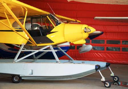 Close-up view of floatplanes (seaplanes) standing in hangar.