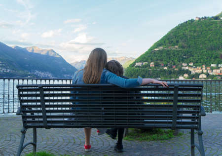 Woman and her daughter resting near the lake Como. Stock Photo