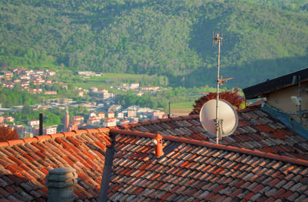Antenna and satellite dish on the roof.