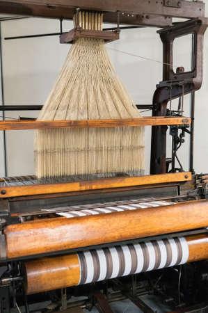 Retro mechanical loom with jacquard harness.
