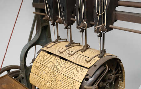 Binding machine. Used to sew together perforated cards for the Jacquard loom. Imagens