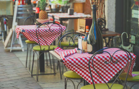 Outdoor cafe terrace exterior with table and chairs.