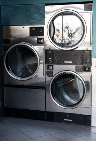 Several washing machines in public laundry.