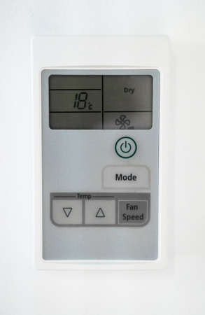 Air conditioning control panel on the wall. Close-up view.