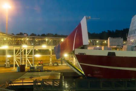 Bow visor of the passenger ship in the port at night.