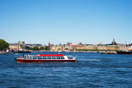 View of the summer Stockholm with sightseeing boat.