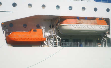 Orange lifeboats on the deck of ferry.