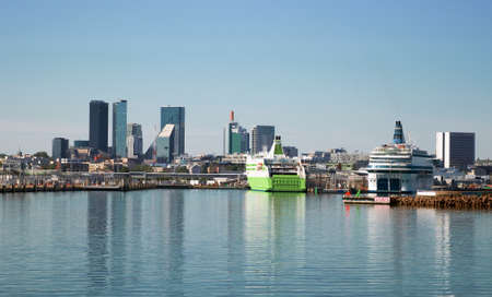 Port of Tallinn with ferries and skyscrapers in Estonia.