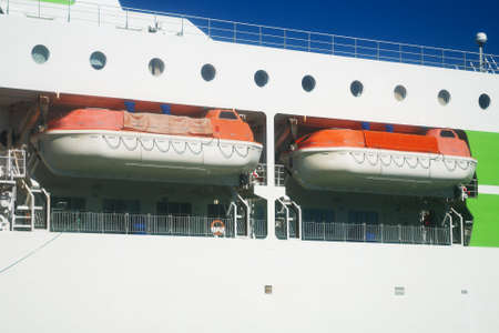 Orange lifeboats on the deck of ferry. Stock Photo - 129929609