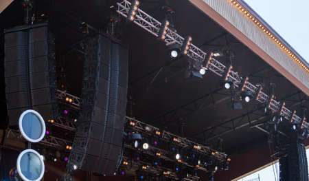 Concert stage with professional loudspeakers and lightning.