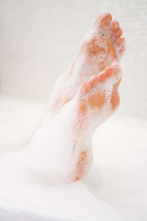 Woman legs in bath with milk. SPA treatments for skin care.