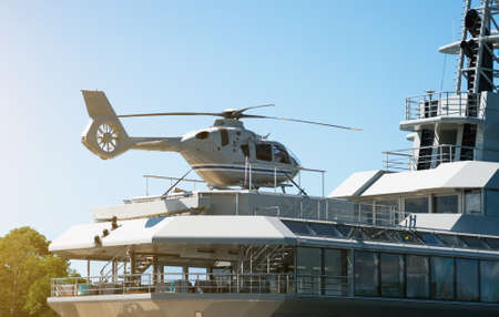 Private luxury ship with helipad. Close-up view. Stok Fotoğraf - 129934302